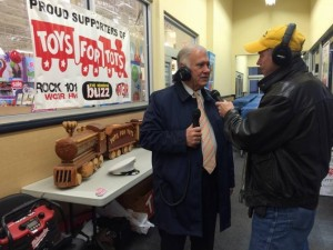 Jack Heath of WGIR-AM interviews Manchester mayor Ted Gatsas during a Toys for Tots drive