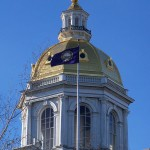 512px-State_House_dome_with_NH_flag_5