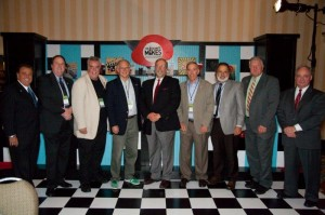 Past Broadcasters of the Year pose with 2014 winner Peter St. James (center).